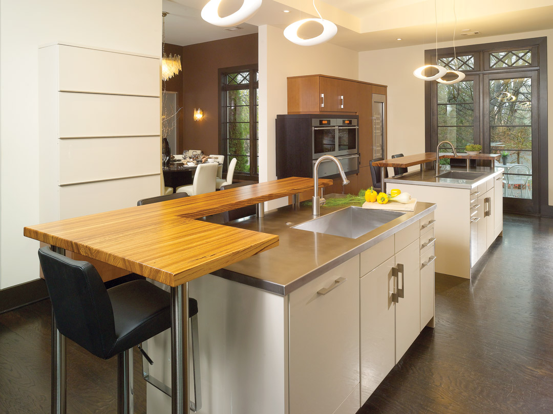 Raised bar top zebrawood island countertop stainless steel faucet