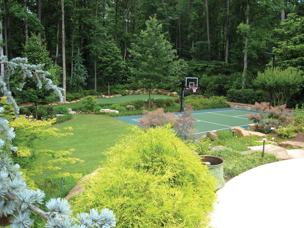 Grass Tennis Court In Backyard : Landscape design with tennis and basketball courts Photo courtesy of