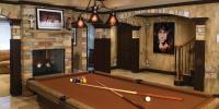 basement with pool table and stone walls