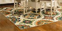 Hardwood kitchen floor with rug