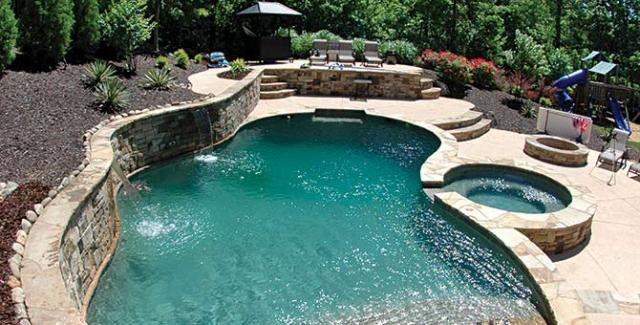 Create an oasis in your own backyard with a pool and spa for Pool design sloped yard