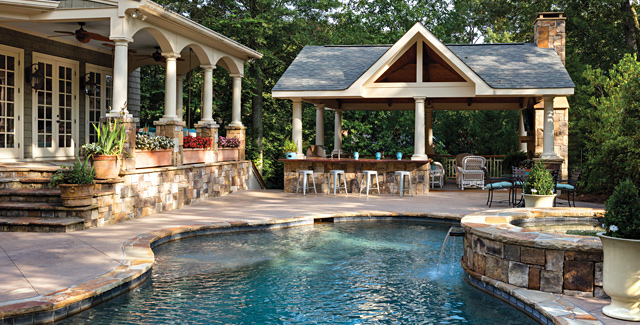 pool with outdoor kitchen rustic outdoor living photo courtesy of boyce design contracting photography by jim roof photo gallery atlanta home improvement