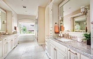 Bathroom design with soaking tub and double vanities