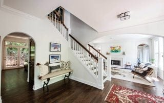Elegant family room leading to staircase