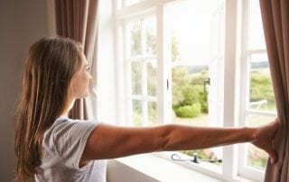 Woman looking out of window at beautiful view