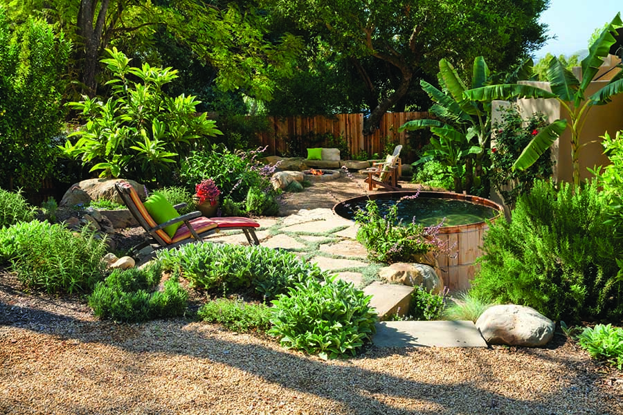 Beautiful landscape with pavers and lush plantings and a spa-like spool by designer Margie Grace