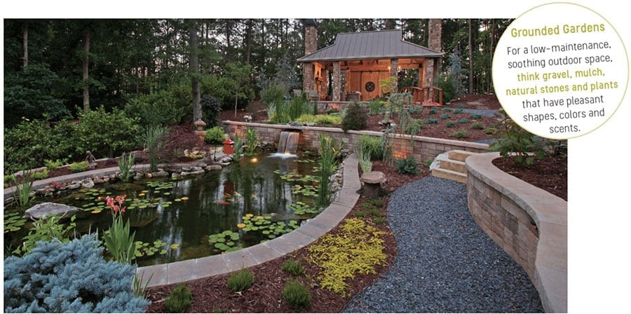 Low-maintenance, soothing outdoor space with a koi pond, gravel path and mulched gardens. Photo courtesy of ModernRusticHomes.com, photography by Tom Harper.