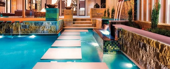 beautiful pool design stepping stones and fire and water features by Neptune Pools