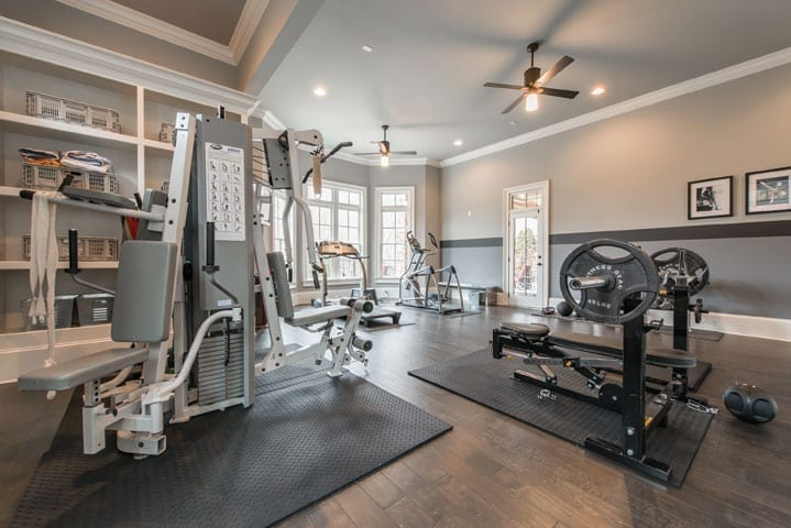 Home fitness center in remodeled basement | Trademark Building Company, photography by Mimi Erickson Photography.