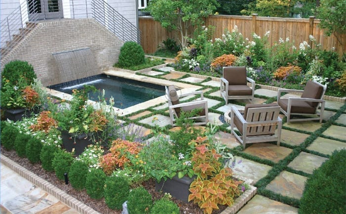 Beautiful backyard design with planters, flowers, brick tiles and pool