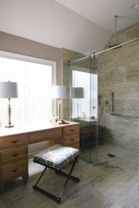 Curbless shower enclosure with teak bench and rain showerhead