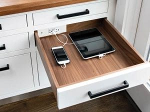Docking Drawer Blade charging outlets with phone and tablet plugged in