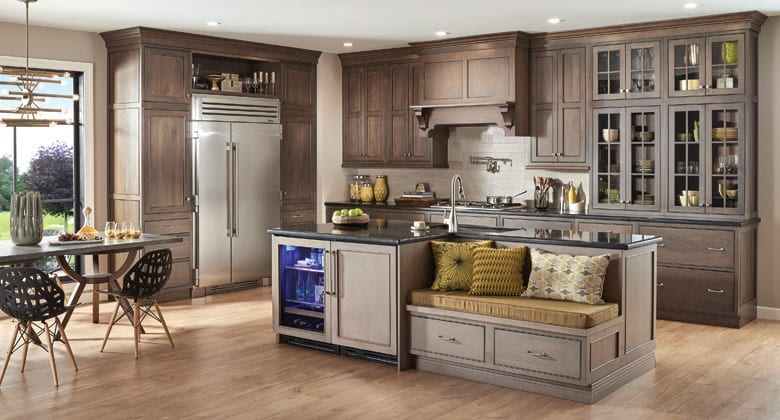 Kitchen with Fieldstone Cabinetry Amsterdam door style and island with banquette