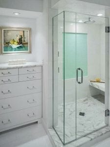 Bathroom with Frameless Shower Enclosure with white cabinets