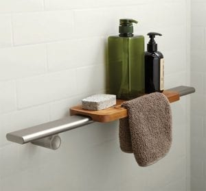 Kohler Choreograph teak tray shelf in bathroom with soap and towel