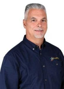 Michael Cangemi wearing a navy polo shirt with B-Level Concrete logo