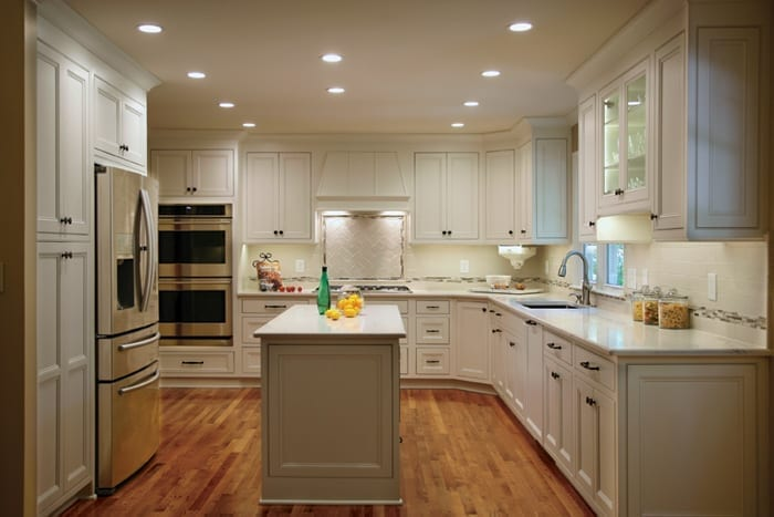 Kitchen design with white cabinets and quartz countertops