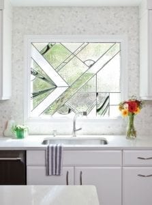 Kichen with stained glass window over sink