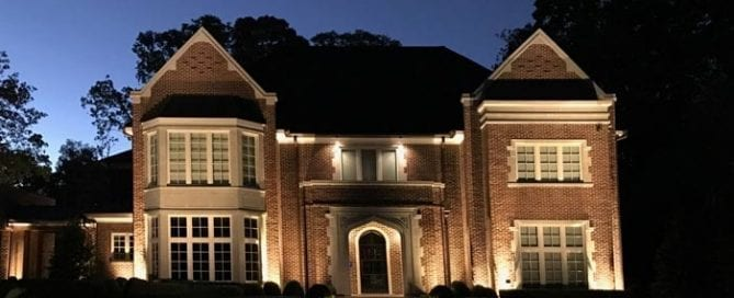 Front yard of a home showing landscape lighting turned on