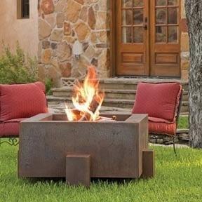 Backyard with lit steel firepit
