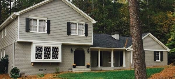 brick house painted gray Painting Plus