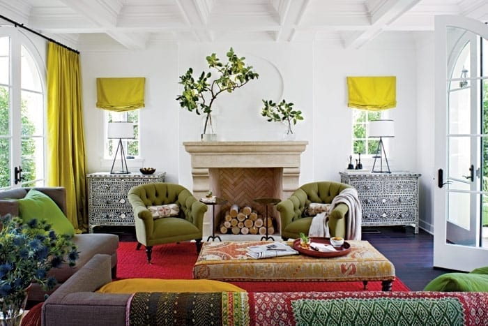 colorful living room with mantel with chevron patterned brick
