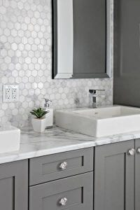 bathroom with marble hex backsplash