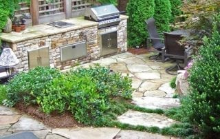outdoor kitchen with lush green landscape