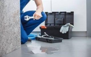 plumber fixing water leak