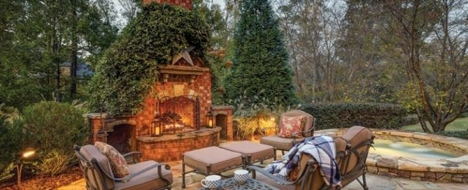 gorgeous patio with wood burning brick fireplace and outdoor furniture
