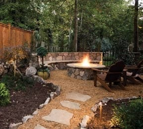 beautiful outdoor space with wood burning fire pit and builtin seating