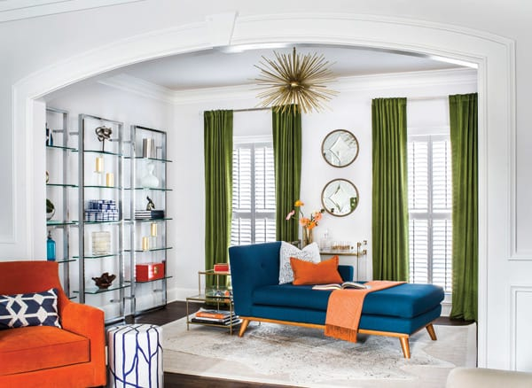 Elegant living room with green, orange and blue pops of color
