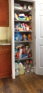 Disorganized pantry before pullout shelves were installed