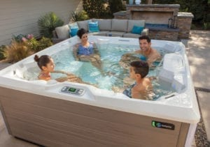 family relaxing in a salt water hot tub