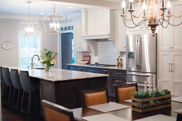 Kitchen with large island, granite countertop and built-in appliances