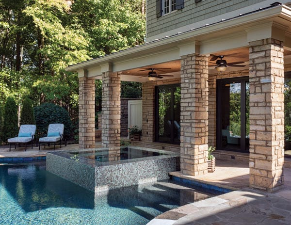 Outdoor living featuring a pool, spa and undercover deck