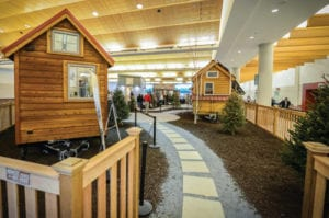 Tiny home village showcasing wooden tiny homes
