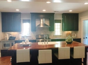 dated kitchen with cabinets painted green - before remodel