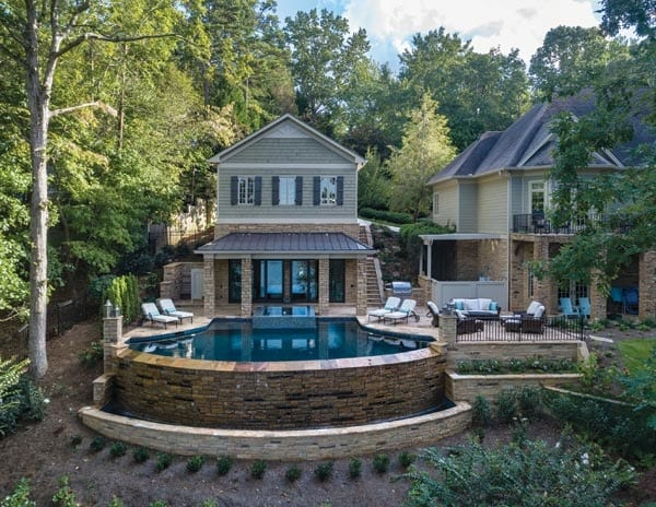 Outdoor living with pool, spa, deck and plantings