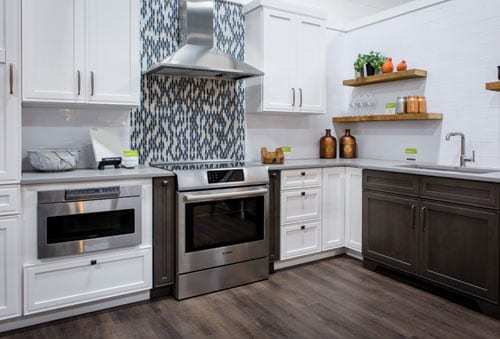 White kitchen with black and white backsplash