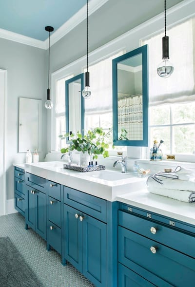 Blue and white bathroom with white countertops