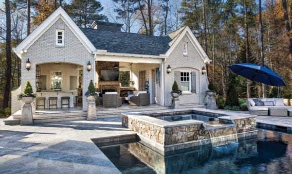 Pool house with kitchen and seating area