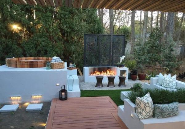 Intimate backyard oasis with raised cedar hot tub