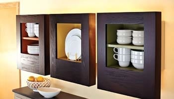 Small display cabinet showcasing white dishes