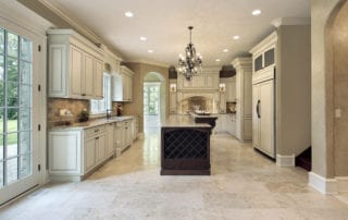 Elegant, neutral color kitchen with brown island