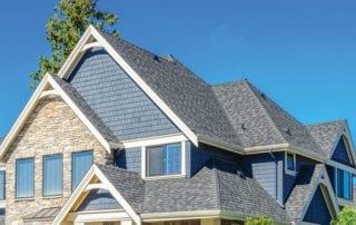 Brick house with shingle roof