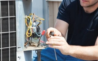 Technician fixing wiring in HVAC