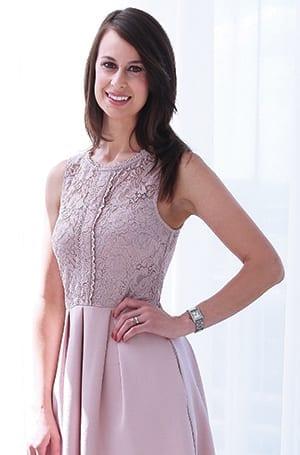 beautiful woman wear a pretty, sleeveless dress