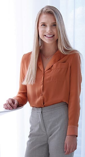 Young woman in burnt orange blouse
