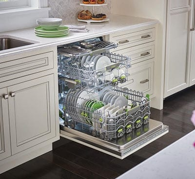 Opened dishwasher filled with dishes